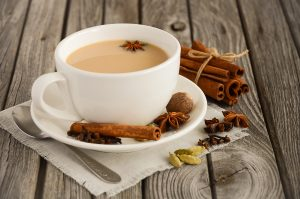 A cup of chai tea with assorted chai spices