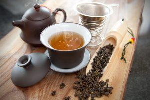 Teapot, cup of oolong tea, and oolong tea leaves